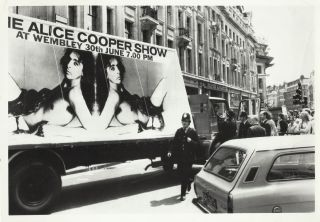 "Six 8"" x 10"" photos of Alice Cooper including two shots of his manager Shep Gordon's 1972 Piccadilly Circus publicity stunt"